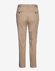 Tommy Hilfiger - TH ESS COTTON TENCEL SLIM CHINO - straight leg trousers - beige - 1