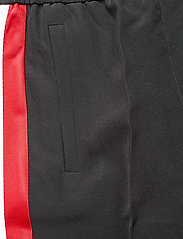 Tommy Hilfiger - TH ESSENTIAL CREPE TRACK PANT - wide leg trousers - meteorite - 4