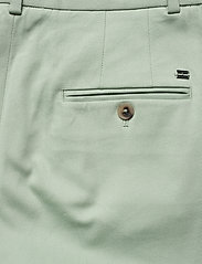 Tommy Hilfiger - COTTON PASTEL TAPERED PANT - straight leg trousers - sea mist mint - 6