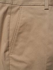 Tommy Hilfiger - TH ESS COTTON TENCEL SLIM CHINO - straight leg trousers - beige - 2