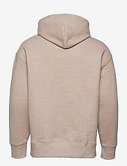 Tommy Jeans - TJM TOMMY BADGE HOODIE - hoodies - soft beige - 1