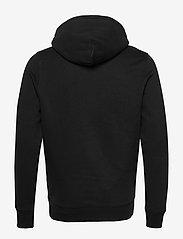 Tommy Jeans - TJM STRAIGHT LOGO HOODIE - hoodies - black - 1
