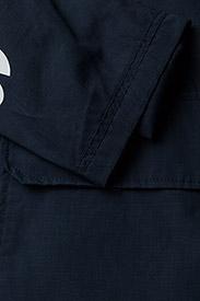 Tommy Jeans - TJM LOGO PULLOVER JA - light jackets - black iris - 4