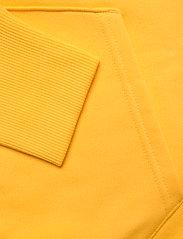 Tommy Jeans - TJM TOMMY BADGE HOODIE - hoodies - starfruit yellow - 3
