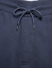 Tommy Jeans - TJM SLIM BOX FLAG SWEAT PANT - joggingbyxor - twilight navy - 2