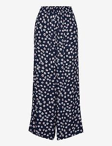 TJW PRINTED FLUID PANT - wide leg trousers - floral print / twilight navy