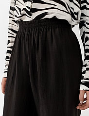 Twist & Tango - Franny Trousers - bukser med brede ben - black - 3