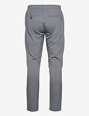 Under Armour - UA Showdown Taper Pant - sportbyxor - pitch gray - 1