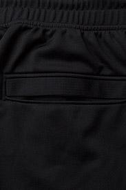 Under Armour - SPORTSTYLE JOGGER - spodnie treningowe - black - 4