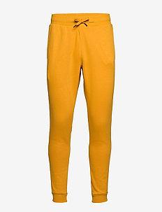RIVAL FLEECE LOGO JOGGER - sweatpants - golden yellow