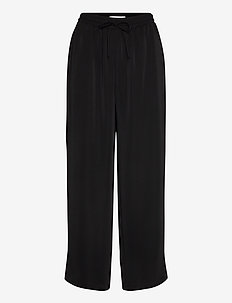 VIBASIKA HWRX 7/8 PANTS - wide leg trousers - black
