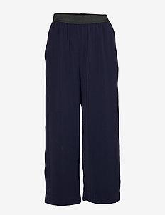 POTTER SOLID - uitlopende broeken - classic navy