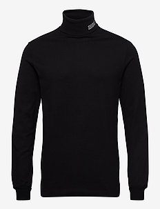 Austin turtleneck - stickade basplagg - black